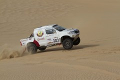 Nasser Al Attiyah flies across the Qatar desert in his Overdrive Toyota on Wednesday..jpg